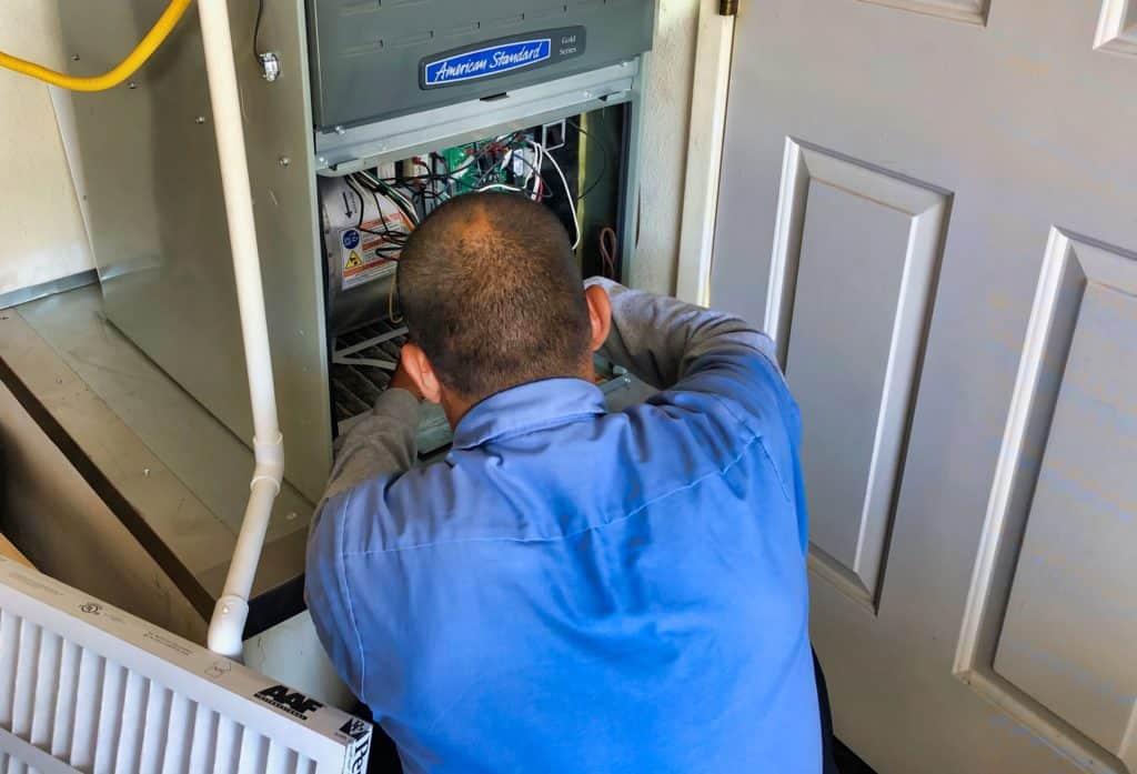 Desert Tech Technician performing maintenance at a customer's home