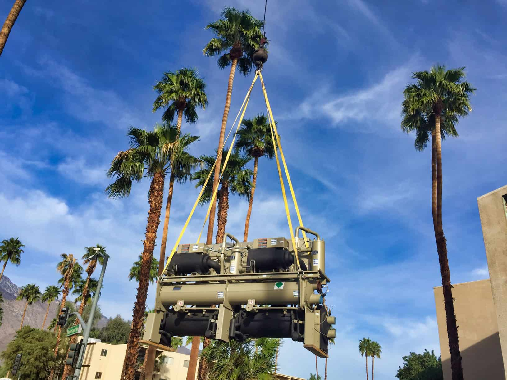 Desert Tech lifting a commercial chiller into place by crane